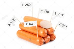 unhealthy-food-concept-chemical-additives-in-food-sausages-isloated-DY7NAX